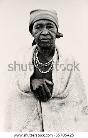 old African woman covered with a blanket ,lomo  black and white look - stock photo