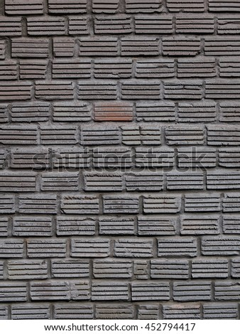 old aged weathered dirty red earthenware ceramic bricks wall construction painted in dark grey color for use as backdrop or background picture - stock photo