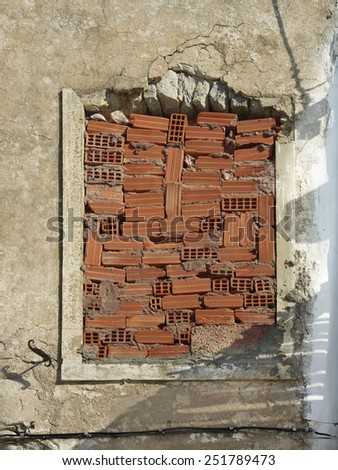 Old aged window fragment, destroyed house. Old abandoned window with selective focus. Ruined building. No people. Aged building - stock photo