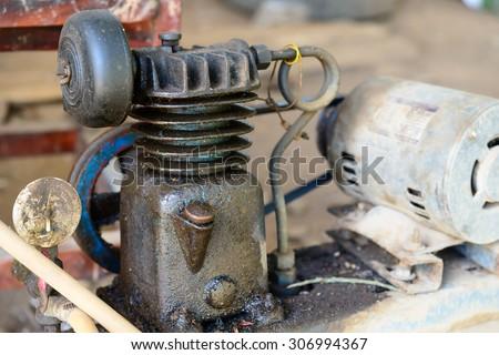 Old air pump compressor - stock photo