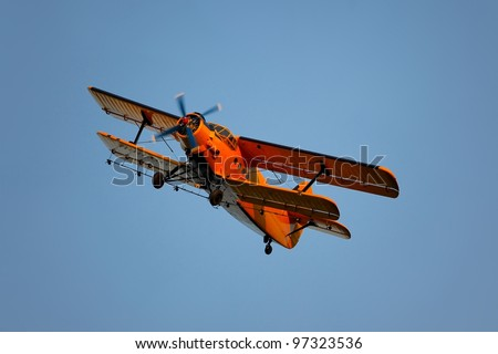 Old aircraft with sprayer device - stock photo