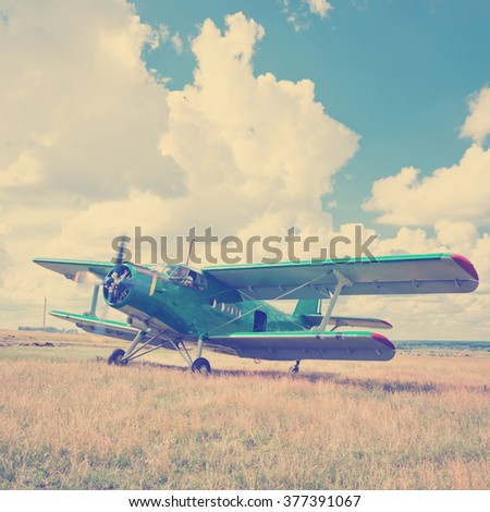 old airplane on green grass . Instagram style filtred image - stock photo