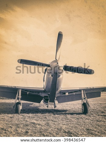Old airplane with propeller at the airfield. Air concept of retro aviation. Retro image of old aircraft. Vintage american airplane closeup. - stock photo