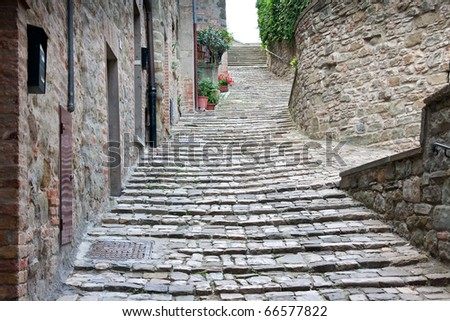 Old alley / steps in Italy, le Marche - stock photo