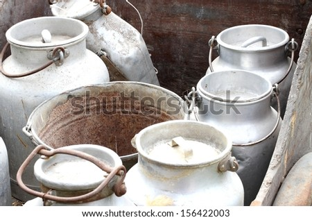 old aluminum containers to carry the fresh milk on farms - stock photo