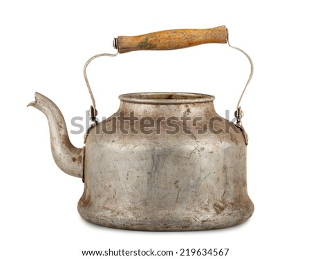 Old aluminum kettle with wooden handle isolated on white background - stock photo