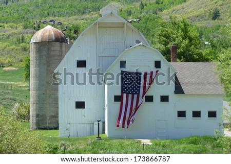 Old american barn with USA flag / Glory Barn / Patriotic - stock photo