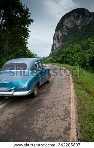 Old american car drive in Cuba rural village - stock photo