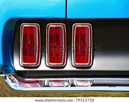 Old American Car/Tail lights of old  Ford Mustang / Oldtimer/ Classic Vintage car/ Automobile/ Stop lights - stock photo