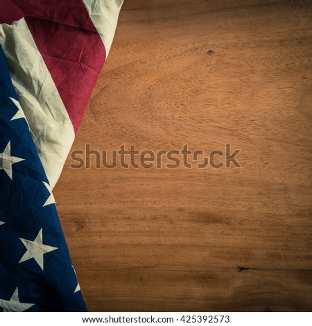 Old American flagon wood background for Memorial Day or 4th of July or Dependence Day, effect by vintage style, vintage image, vintage tone - stock photo