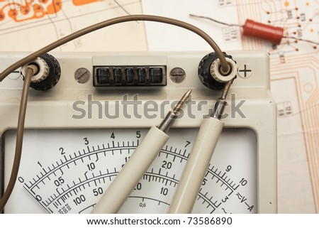 old analog multimeter and electronic component - stock photo