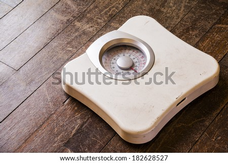 Old analog weight scale - stock photo