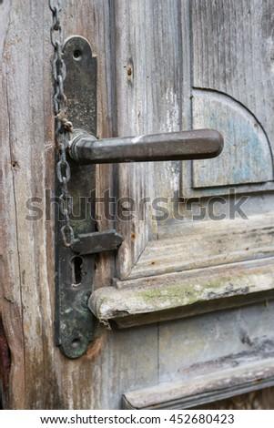Old ancient classic door handle vintage doorway  - stock photo