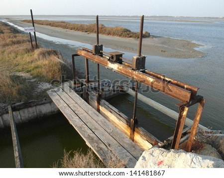 Old Ancient Rusty Water Dam in Camargue, France - stock photo