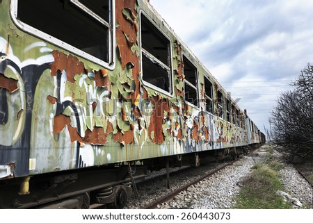 Old and abandoned passenger train wagons - stock photo