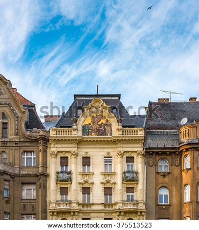 Old and beautiful architecture of Budapest, Hungary, Europe. Building in foreground with blue sky and clouds in background. - stock photo