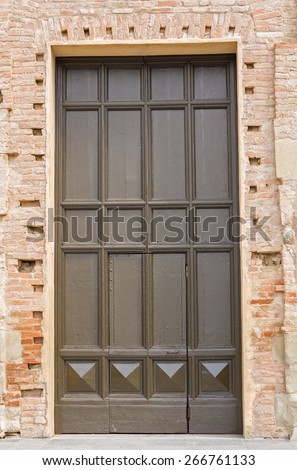old and big brown wooden door, closes the access of a church - stock photo