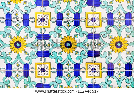 Old and colorful italian painted tiles with interesting designs - stock photo