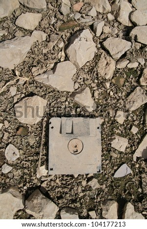 old and dirty floppy disc on ground - stock photo