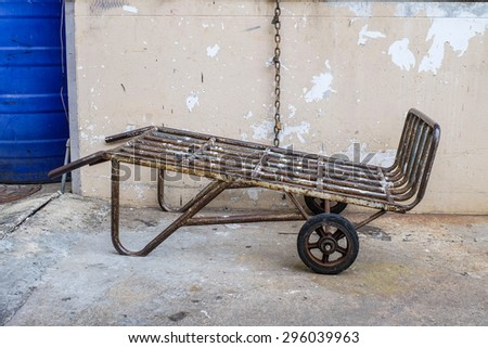 Old and dirty metal barrow - stock photo