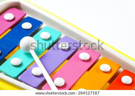 Old and dirty plastic toy xylophone rainbow color for children with drum stick represent the music instrument concept related idea.    - stock photo