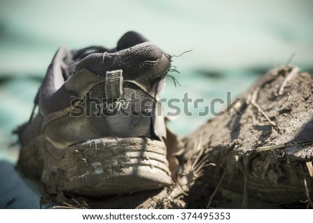 Old and dirty sport shoes. Shallow depth of field. Vintage style photo - stock photo