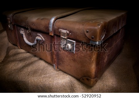 Old and dirty suitcase, low key - stock photo
