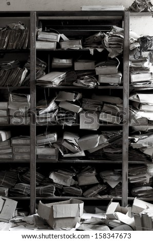 Old and dusty archive of papers in forgotten place - stock photo