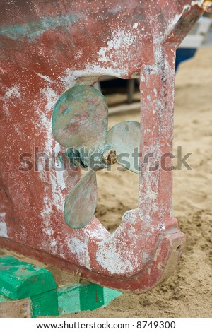 Old and grunge boat propeller - stock photo