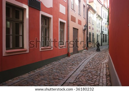 Old and narrow street in the old town of Riga (Latvia) - stock photo