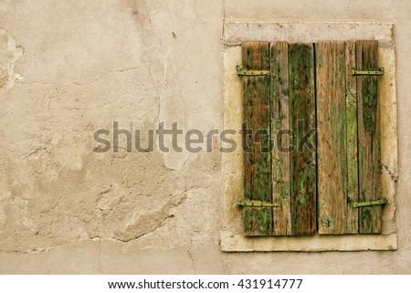 Old and nostalgic window on concrete wall - stock photo