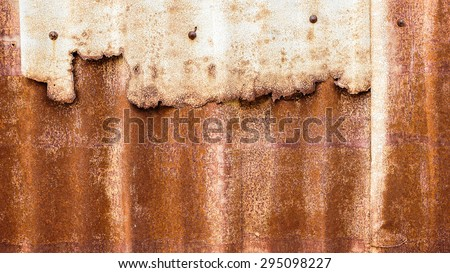 Old and Rusted decay metal sheet wall - stock photo