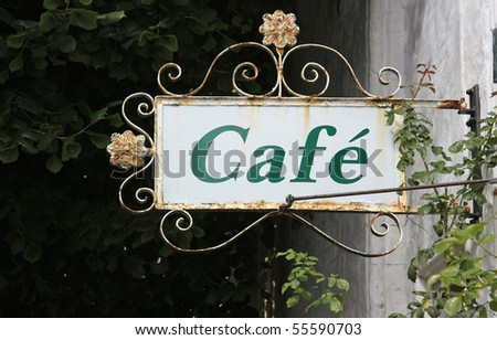 Old and rusty Cafe Sign - stock photo