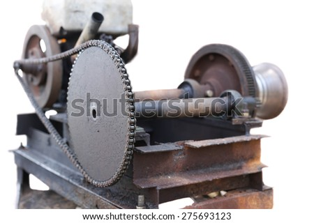 Old and rusty engine with chain in white background - stock photo