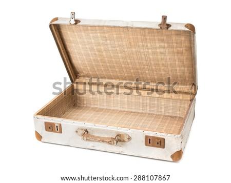 old and rusty opening aluminium suitcase on white background - stock photo