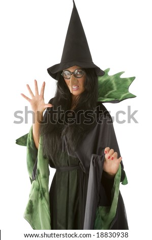 old and ugly witch in black and green dress with glasses - stock photo
