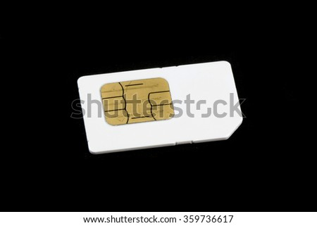Old and used  mobile sim card isolated on black background. - stock photo