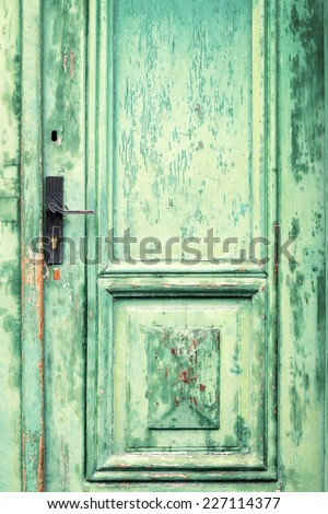 Old and weathered green door texture - stock photo