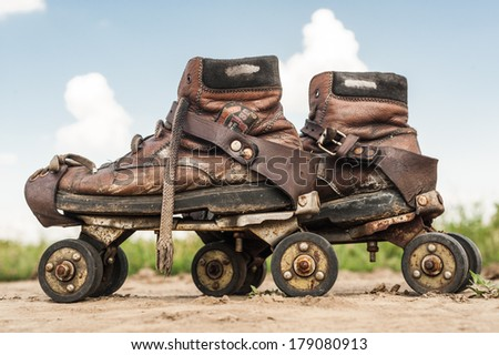 Old and worn and rusty rollers in the dirt - stock photo