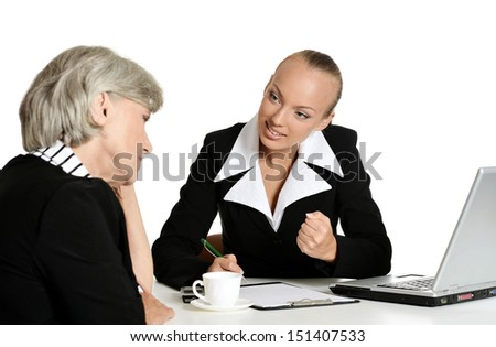 Old and yound businesswomen - stock photo
