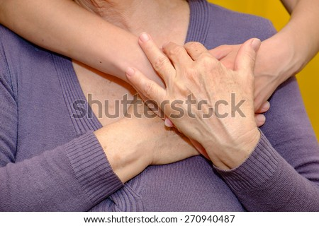 Old and young hands - stock photo