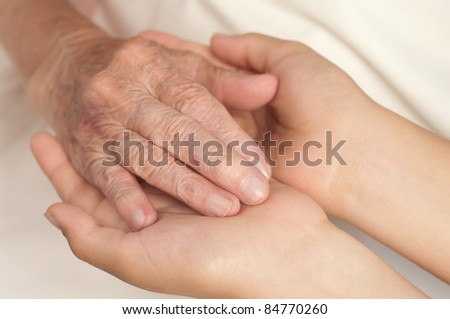 Old and young hands. - stock photo