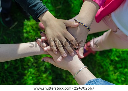 Old and young hands. Hands of the old woman  76 years - stock photo