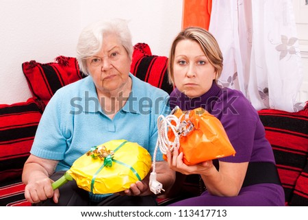 old and young woman are getting improper gifts - stock photo