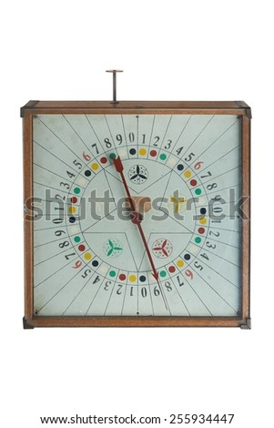 Old antic gamble spin clock on clean background - stock photo