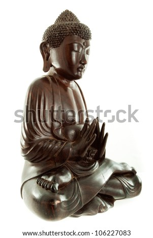 Old antique Budda in Thai style made from wood, isolated on white background, subject is not under copyright - stock photo