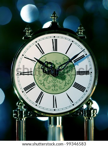 Old antique clock against abstract background - stock photo