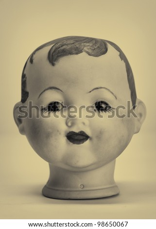 Old antique doll head - stock photo