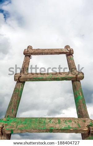 Old antique ladder to blue beautiful heaven sky - stock photo