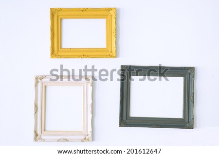 Old antique picture frame on wall. Vintage style decorate - stock photo